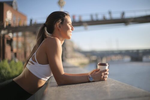 Female athlete with coffee